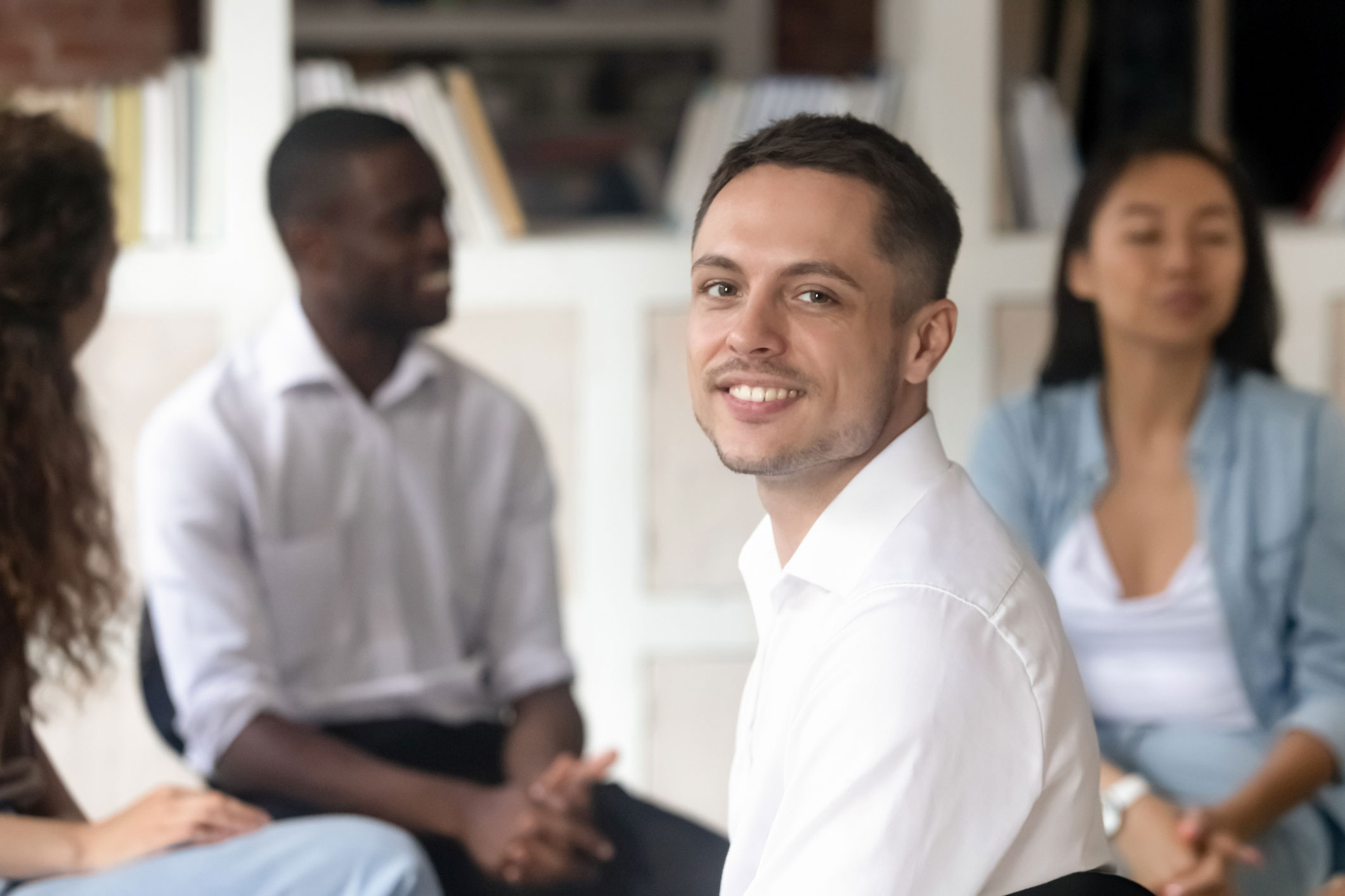 smiling man at group therapy session