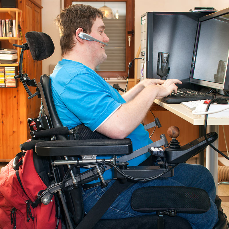 wheelchair bound individual working on a computer