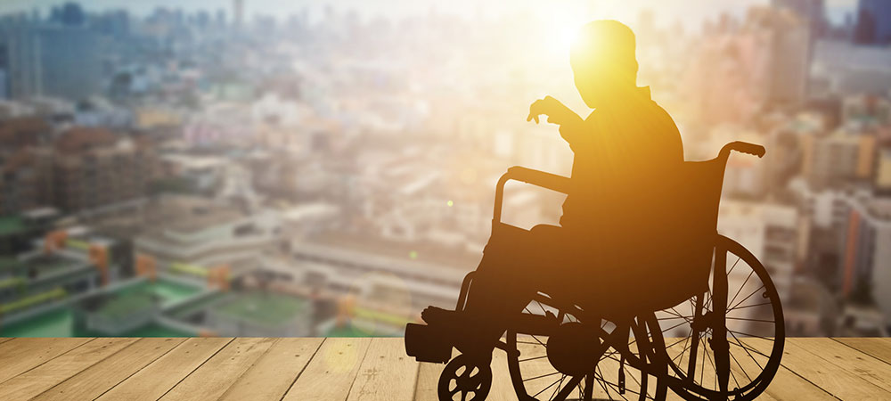 wheelchair bound man looking at city skyline