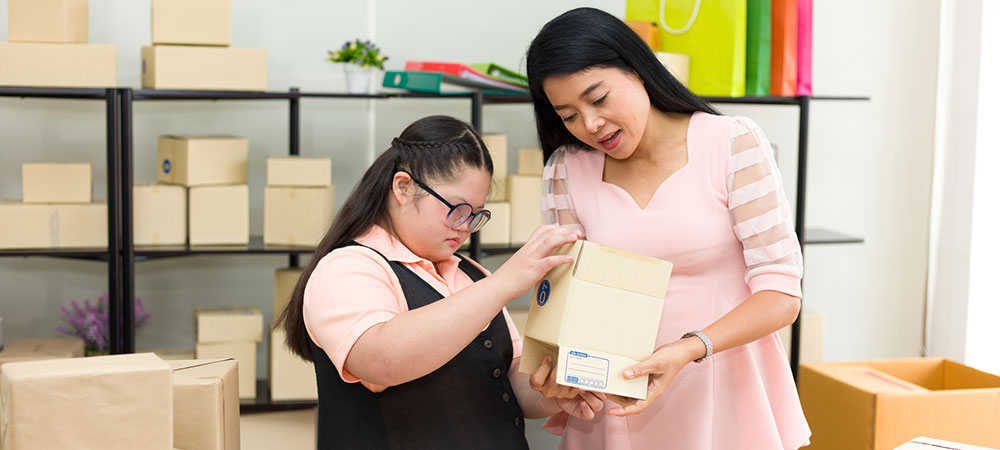 developmentally disabled woman working with a job trainer